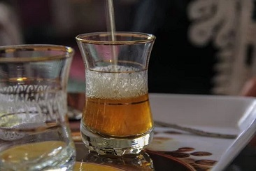 Glass of Moroccan Tea With Foamy Head